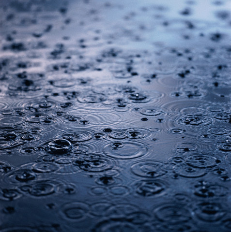 Raining on Puddle of Water --- Image by © Anthony Redpath/Corbis